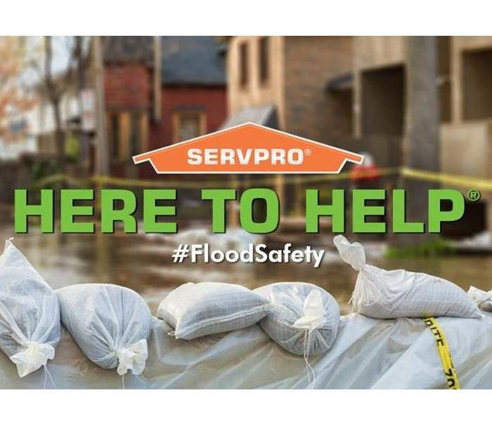 Flood waters with sandbags