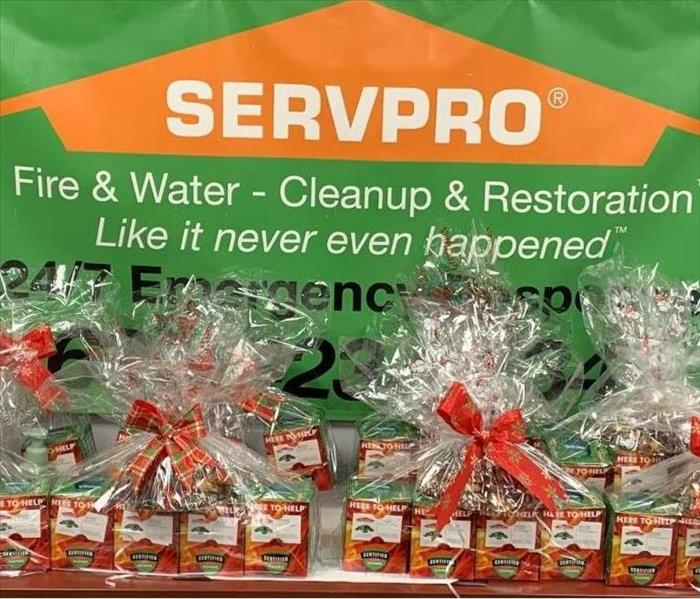 Baskets of SERVPRO branded essential items